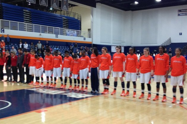 Cal State Fullerton players observe a moment of silence before Saturday's game (via @VikkiNBCLA)