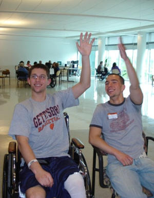 Weissman high-fiving his brother after regaining function in his left arm (Jeremy Weissman)