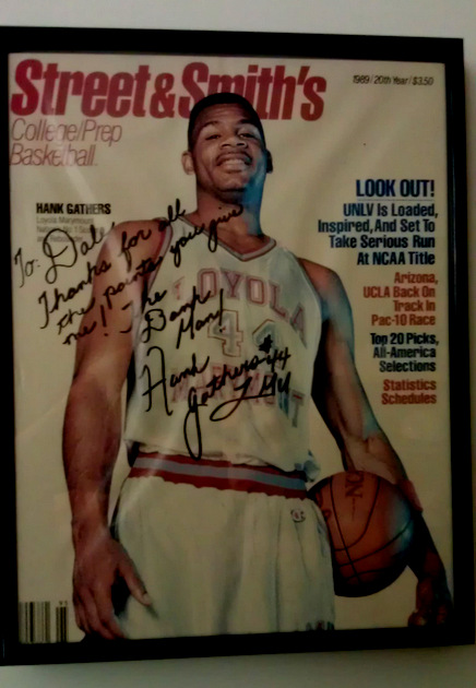 An autographed Hank Gathers Street & Smith's cover hangs in Dale Marini's office (via Dale Marini)
