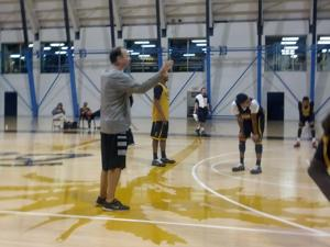 Dan Monson instructs the team at Wednesday's practice (Jeff Eisenberg)