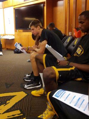 Long Beach State players read over the scouting report on North Carolina (Jeff Eisenberg)