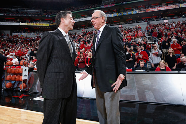 Rick Pitino and Jim Boeheim chat before the January Louisville/Syracuse game. (Getty Images)
