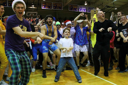 "The crowd helps a boy perform ""Gangnam Style"" at halftime (photo via Taylor Athletics)"