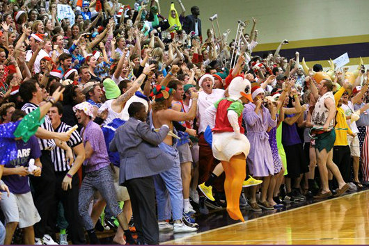 The costume-clad crowd enjoys this year's Silent Night game (photo via Taylor athletics)