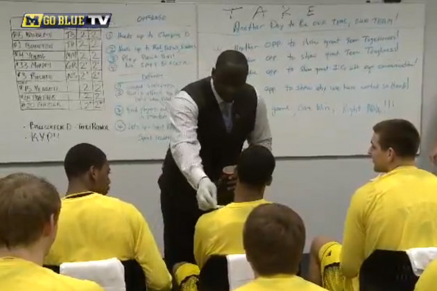 Bacari Alexander placed Pringles chips on the shoulders of each Michigan starter (via YouTube)