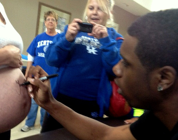 Terrence Jones signs a pregnant woman's belly (via @terrencejones1)