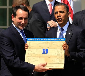 Mike Krzyzewski presents President Obama with a Duke-centric bracket in 2010. (Getty Images)