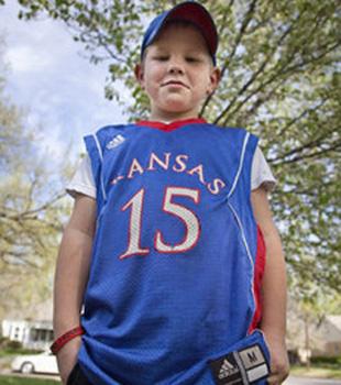 Eight year old Kansas Jayhawks fan refuses to take off jersey