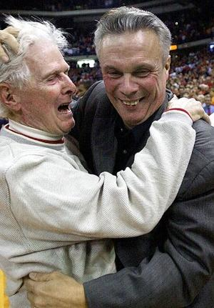 Butch and Bo Ryan after Wisconsin upset Illinois during the 2001-02 season (AP)