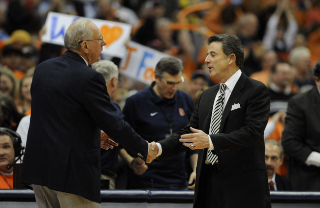 Jim Boeheim and Rick Pitino shake hands at last year's Syracuse-Louisville game (US Presswire)