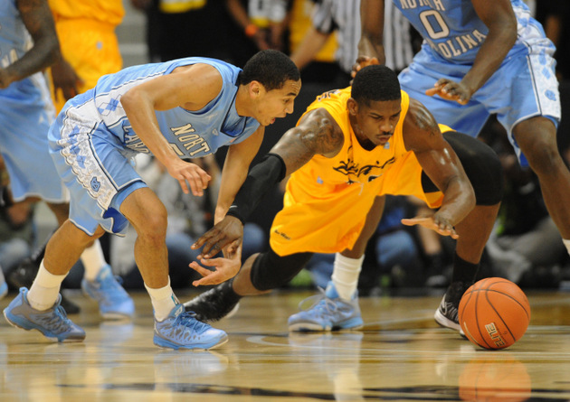 Dan Jennings and Marcus Paige battle for a loose ball (US Presswire)