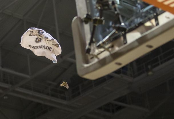 Players throw a towel at a bat flying in the Bradley Center during Saturday's game (USA Today Sports Images)