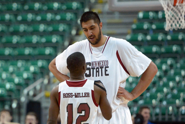 Sim Bhullar and 6-foot-1 guard K.C. Ross-Miller (USA Today Sports Images)