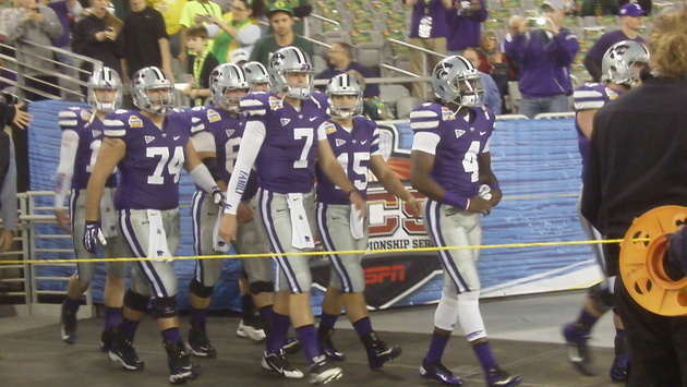 Collin Klein and teammates take the field for warmups