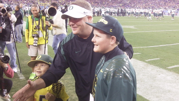 Chip Kelly meets some fans on the sideline before the game