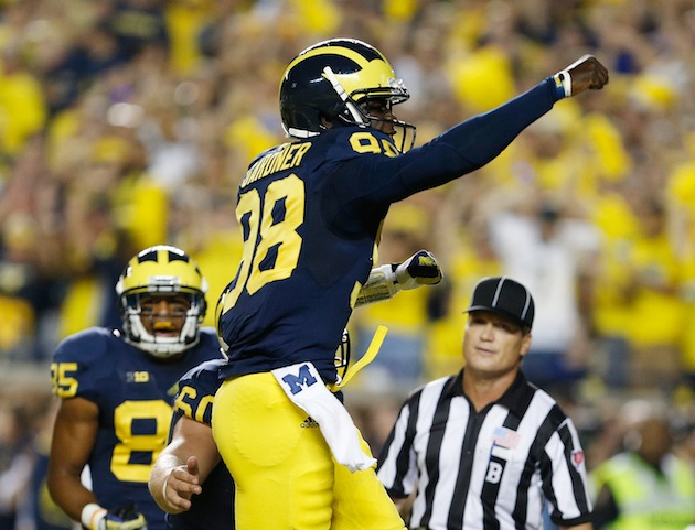Devin Gardner celebrates one of his five touchdowns against Notre Dame. (Getty)
