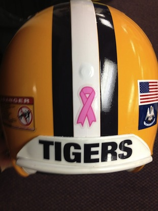LSU puts pink ribbons on the back of their helmets against South Carolina