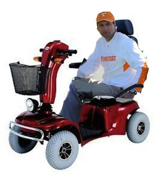 Derek Dooley cruises around practice in a golf cart (poor Photoshopping included)