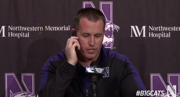 Pat Fitzgerald answers reporters phone during a press conference then is disappointed when he switches recorders the following day
