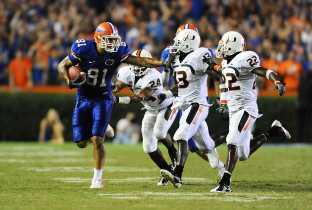 Hurricane defenders attempt to tackle Aaron Hernandez during the 2008 Florida/Miami game. (James Lang/USA TODAY Sports)