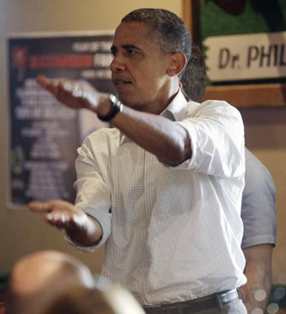 President Obama does the 'Gator Chomp' at a Florida sports bar