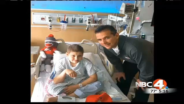 Grant Reed with Ohio State coach Urban Meyer. (image via NBC4i.com screen grab)