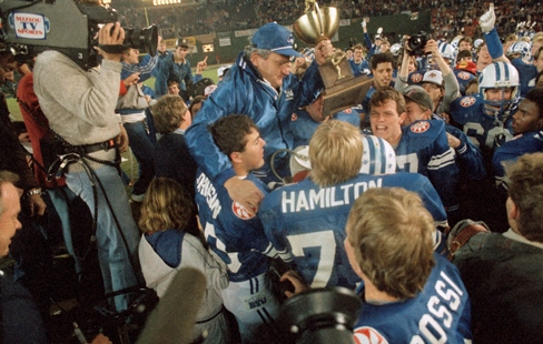 Coach LaVell Edwards is carried off after the 1984 Holiday Bowl (AP)