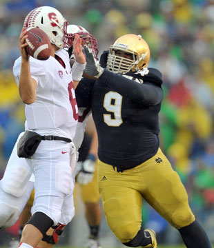 Louis Nix in pursuit of Stanford quarterback Josh Nunes. (Matt Cashore/USA TODAY Sports)