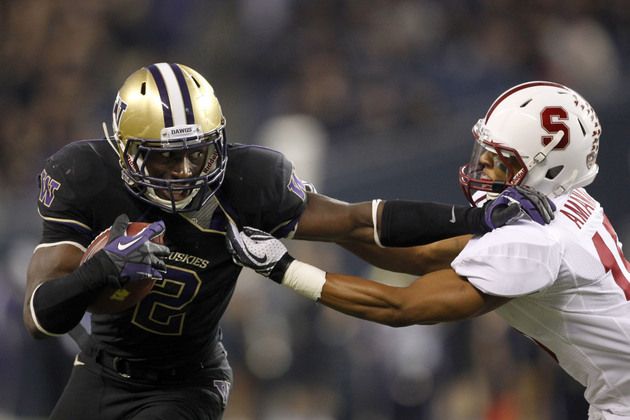 Washington receiver Kasen Williams stiff-arms Stanford's Usua Amanam (US Presswire)