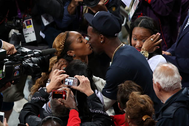 Sanya Richards-Ross and Aaron Ross after she won gold in London. (Getty)