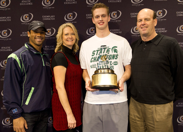 Max Browne with Russell Wilson (l.), and proud parents Mike and Cheryl. (Susan Goldman/Gatorade)
