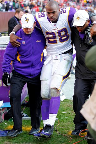 Peterson after he injured his knee on Dec. 24, 2011 (USA Today Sports Images)