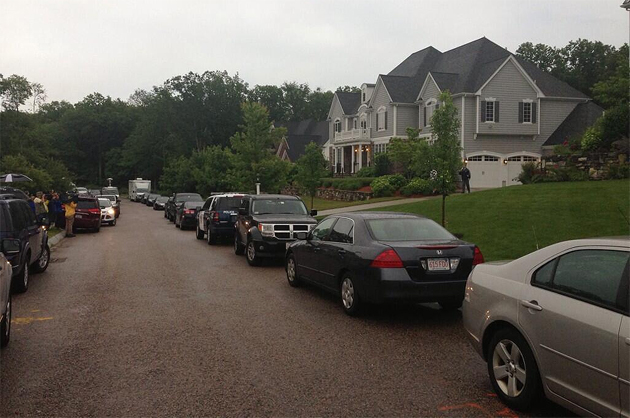 Police and media gather at Aaron Hernandez's house. (@GregABedard)