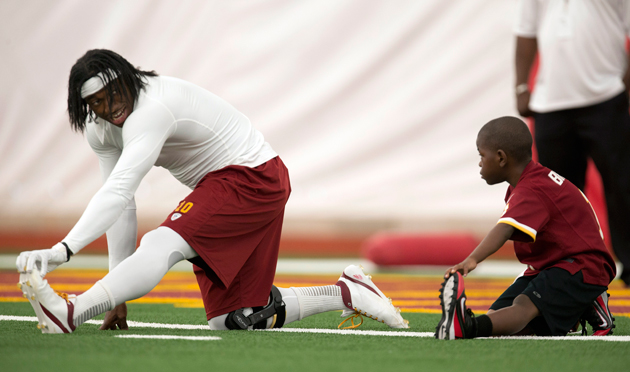 Lateef Brock warms up with his new quarterback. (AP)