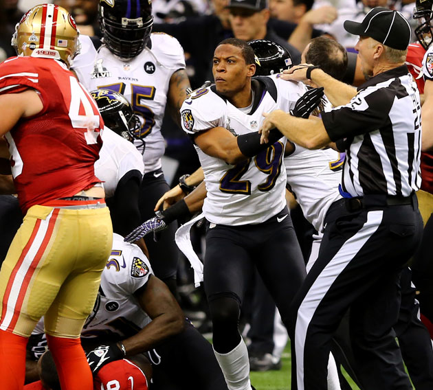Cary Williams (29) in mid-ref push. (Getty Images)