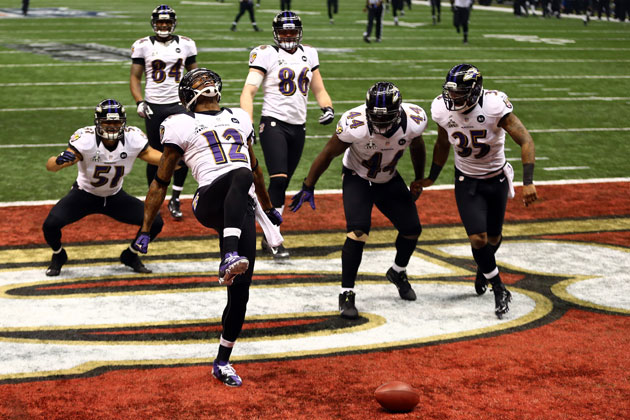 Jacoby Jones celebrates his runback with a tribute to Ray Lewis. (Getty Images)