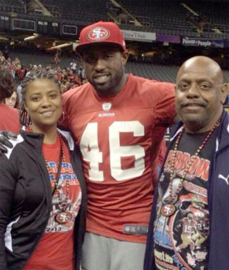 Alice and Bryan Young flank Delanie Walker at the Super Bowl.