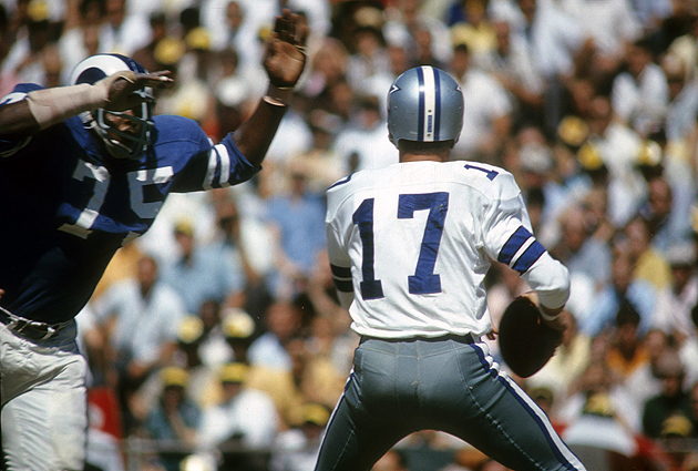 Deacon Jones bears down on Dandy Don Meredith in 3... 2... 1... (Getty Images)