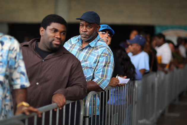 People stand in line at a May 2 job fair at Sun Life Stadium. (Getty Images)