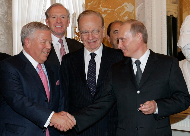 Robert Kraft and Vladimir Putin in 2005: Kraft is eyeing his ring with good reason. (AP)