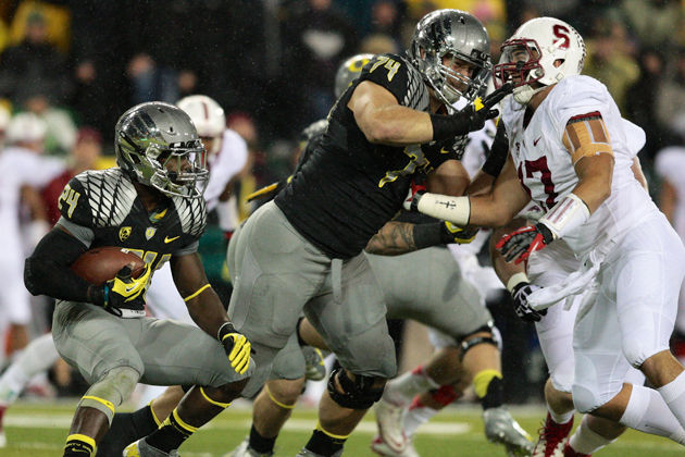 Kyle Long pancakes his man against Stanford. (Getty Images)