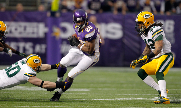 This just in: Adrian Peterson is more valuable than his quarterback. (AP)