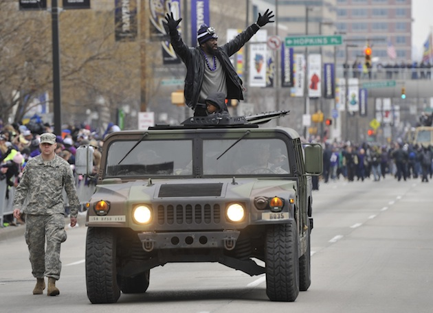 Ed Reed rides in Tuesday's Super Bowl parade. (AP)