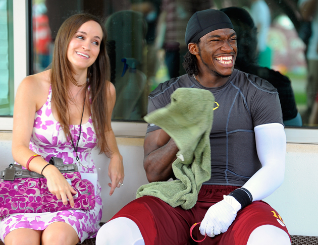 """You bought us a WHAT?"" RG3 and Rebecca Liddicoat in July, 2012. (Getty Images)"