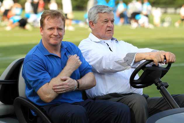Jerry Richardson in 2011, presumably explaining to Roger Goodell how much it costs to gas up his cart. (Getty Images)