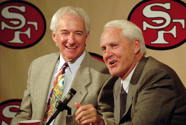 George Seifert and Bill Walsh were the last men to get the 49ers to the top. (AP)