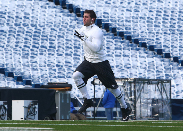 Tim Tebow warmsup in Buffalo, which may be as close as he ever gets to Canada. (Getty Images)