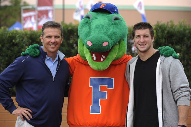 Urban Mayer in happier times, with Albert the Alligator and Tim Tebow. (Getty Images)