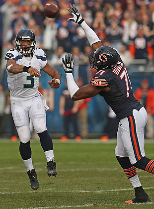 "This could be scored, ""Russell Wilson 1, NFL Height Bias 0."" (Getty Images)"