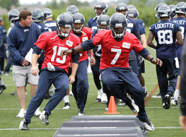 Tarvaris Jackson (7) leads the Seahawks' QB derby, but folks are nipping at his heels. (AP)